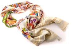Fashionable beige female scarf isolated on white Royalty Free Stock Photo