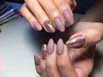 fashionable beige matt manicure stock photo