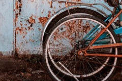 Fashionable bicycle wheels. Two wheels off the bike next to the rusty garage Royalty Free Stock Photography