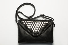 Fashionable black leather woman`s bag with metal decoration Royalty Free Stock Image
