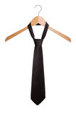 Fashionable black man's tie on a hanger. Stock Photo