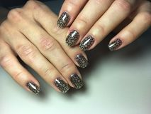 Fashionable black manicure with stained glass design royalty free stock image
