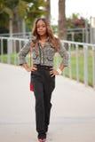 Fashionable black model walking Stock Photos