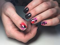 Fashionable black with pink manicure stock photos