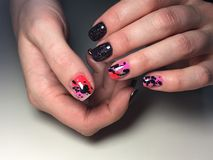 Fashionable black with pink manicure stock photo