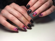 Fashionable black with pink manicure royalty free stock photos
