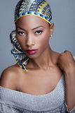 Fashionable black woman. Fashionable young black woman in head scarf, studio background Royalty Free Stock Photos