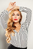 Fashionable Blond Hair Woman with Long Curly Blonde Hairstyle. And Makeup Royalty Free Stock Photography
