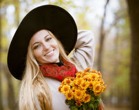 Fashionable blond woman at beautiful autumn alley Royalty Free Stock Images