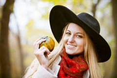 Fashionable blond woman at beautiful autumn alley Stock Photo
