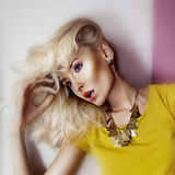 Fashionable blonde beauty posing in studio. Royalty Free Stock Photos