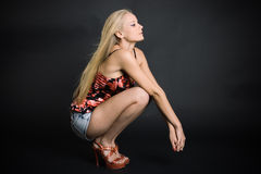 Fashionable blonde in denim shorts Royalty Free Stock Photography