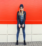 Fashionable blonde girl in rock black style Royalty Free Stock Photo