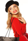 Fashionable Blonde Giving Over-the-shoulder Look. Fashionable blonde woman in chic red outfit and hat giving over-the-shoulder look Royalty Free Stock Photography