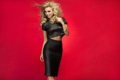 Fashionable blonde lady posing. Royalty Free Stock Image