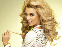Fashionable blonde lady posing. Royalty Free Stock Images