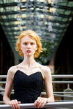 Fashionable blonde woman in black dress royalty free stock image