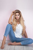 Fashionable blonde woman on pink background. Royalty Free Stock Image
