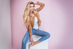 Fashionable blonde woman on pink background. Stock Image