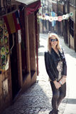 Fashionable blonde woman posing outdoor Stock Photography
