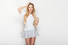 Fashionable blonde woman posing. Stock Photos