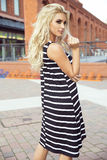 Fashionable blonde woman posing. Young fashionable beautiful blonde woman posing outdoor in casual clothes. Girl with long curly hair stock photos