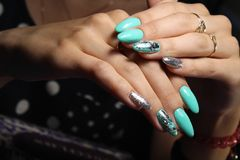 Fashionable blue manicure. Of nails on a beautiful textural background Stock Photography