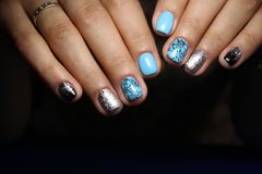 Fashionable blue manicure. Of nails on a beautiful textural background Royalty Free Stock Photo