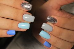 fashionable blue manicure royalty free stock photography