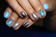 Fashionable blue manicure. Of nails on a beautiful textural background Royalty Free Stock Images