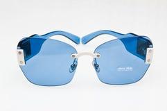 Fashionable blue sunglasses of Miu Miu brand royalty free stock photos