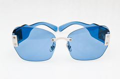 Fashionable blue sunglasses Stock Photography
