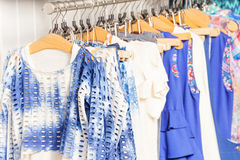 Fashionable blue and white clothes in the shop Stock Photo