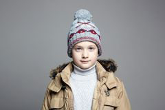 Fashionable Boy in winter outerwear stock photo