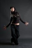 Fashionable breakdancer posing. Against dark background Stock Image