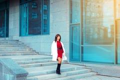 Fashionable brunette adult woman walks outdoors Stock Photos