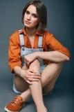 Fashionable brunette beautiful woman posing in studio Stock Image