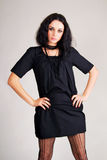 Fashionable brunette in black dress Stock Photo