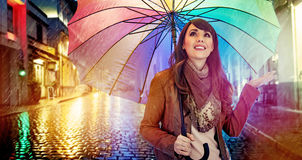 Fashionable brunette with a colorful umbrella. Fashionable brunette lady with a colorful umbrella Stock Image