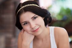 Fashionable brunette girl with golden chain in hair Royalty Free Stock Image