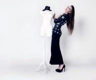 Fashionable brunette girl posing. Royalty Free Stock Images
