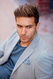 Fashionable brunette hair man in jacket Stock Images