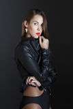 Fashionable brunette woman in leather jacket royalty free stock image