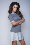 Fashionable brunette woman posing. Royalty Free Stock Photography