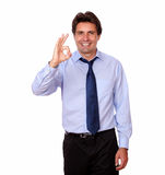 Fashionable businessman standing with ok sign Royalty Free Stock Photos