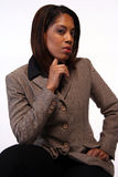 Fashionable businesswoman. Half body portrait of fashionable black businesswoman, white studio background Stock Images