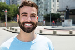 Fashionable caucasian man with beard outdoor in city Royalty Free Stock Photos