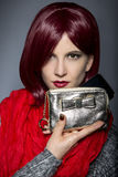 Fashionable Cell Phone Case. Redhead fashion model holding a stylish cell phone purse accessory Stock Photos
