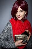 Fashionable Cell Phone Case. Redhead fashion model holding a stylish cell phone purse accessory Stock Photography