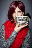 Fashionable Cell Phone Case. Redhead fashion model holding a stylish cell phone purse accessory Stock Image